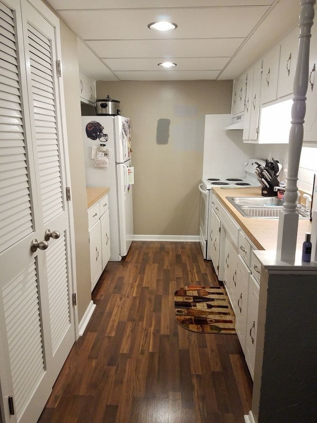 q what color wall should i go with if i have a modern wine theme kitchen