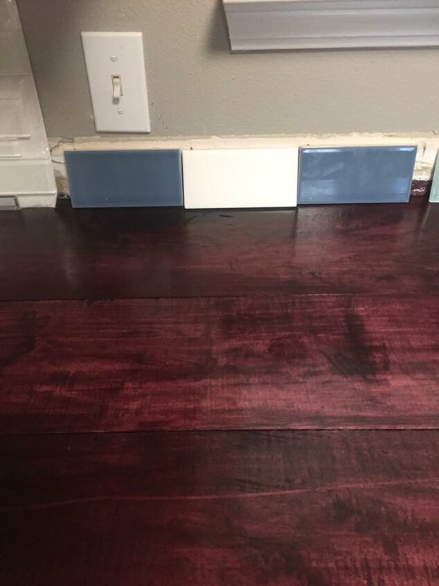 q which color backsplash looks best with this black cherry counter top