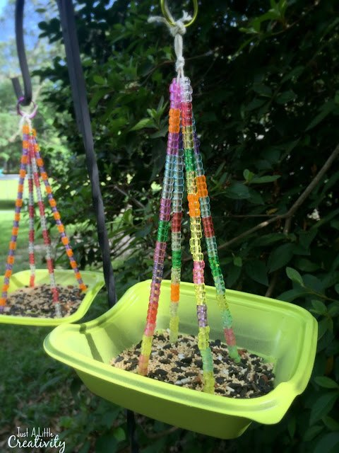 s 13 bird feeders from upcycled items, Salad Container Transformed