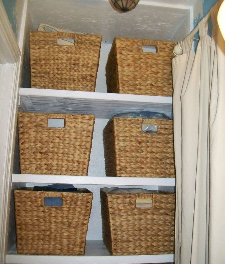 old heater closet turned into a linen and catch all closet