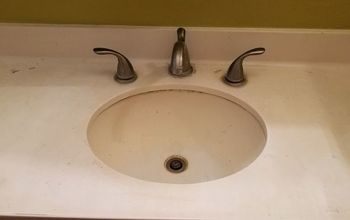How can I makeover my bathroom sink countertop.It has stains, &cracks