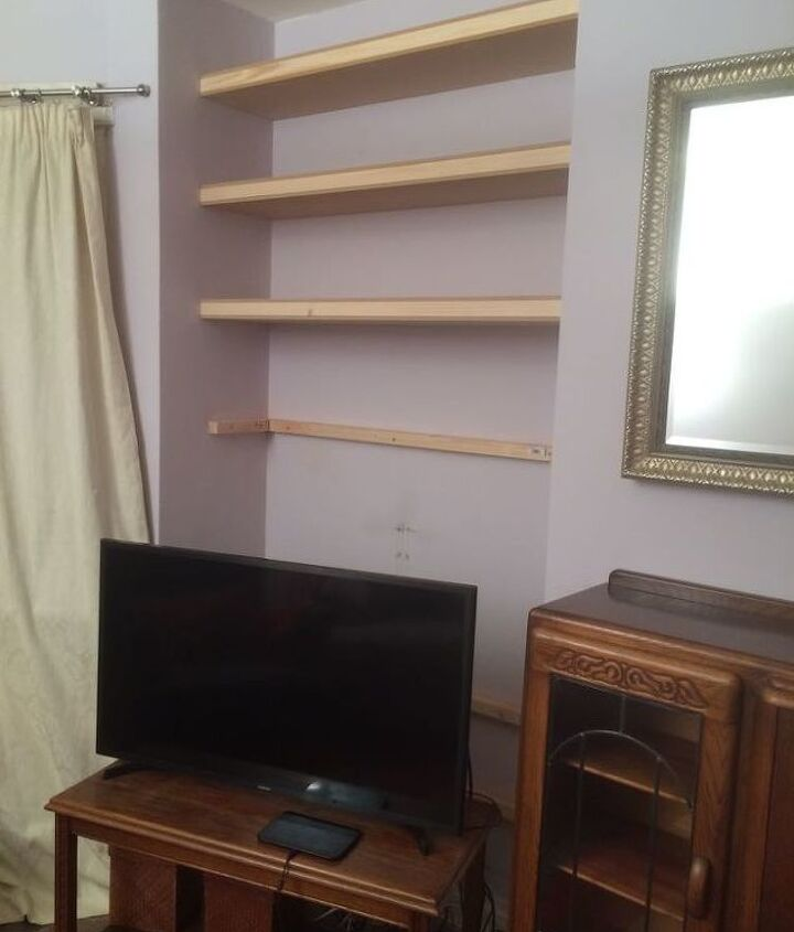 organizing books and tv with built in alcove shelving