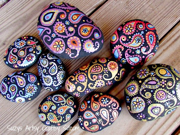 s these clever decor ideas are so perfect for summer, Pretty Painted Stones for Your Garden
