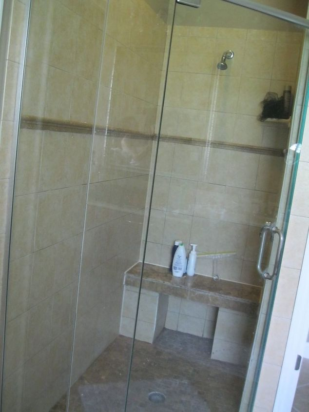 q whats more in for tile in the shower large tile or the sub way tile