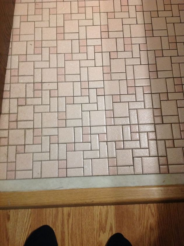q i have a bathroom with little square floor tiles ugly