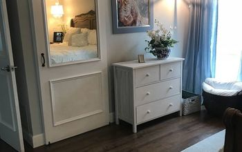 Pretty Sliding Barn Door.  It Slides Behind a Dresser.