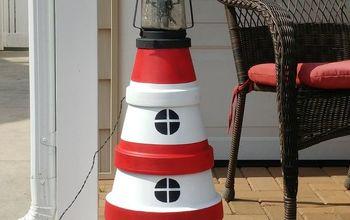 terra cotta pot lighthouse with solar light