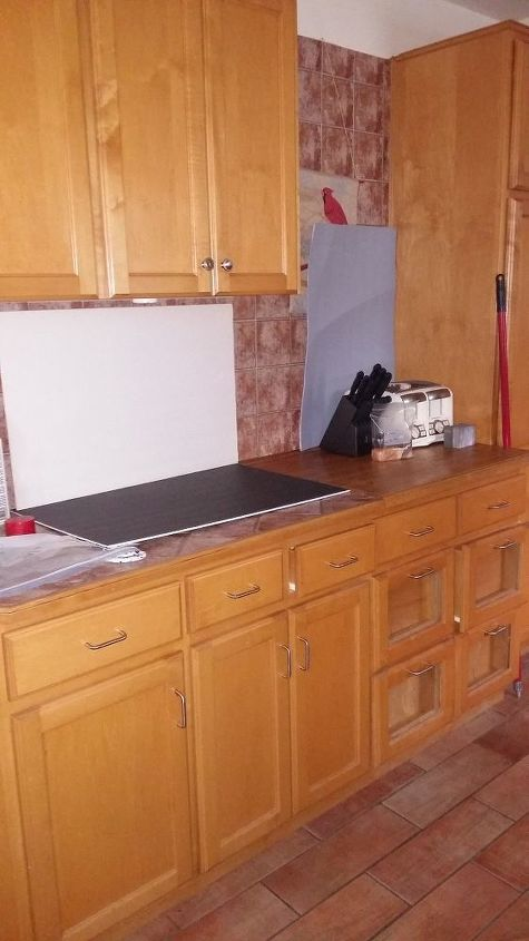 q what to do with my back splash and counters not doing my cupboards