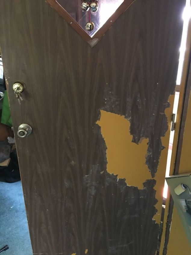 q how to remove stuck on paint from a very old mobile home door