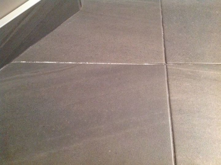 q how to clean white mineral deposits off of dark grout
