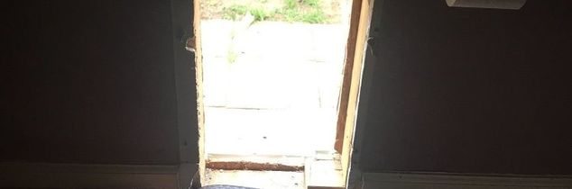 q how to repair an exterior wall hall from a doggie door