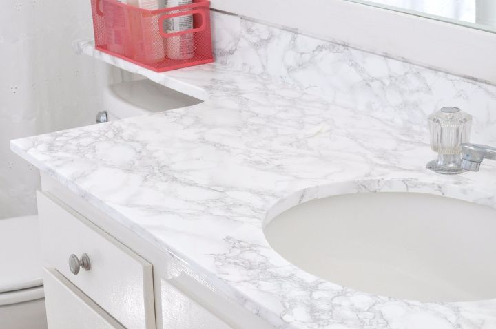 s 15 bathroom upgrades that you can totally diy, Make The Countertop Look Like Marble
