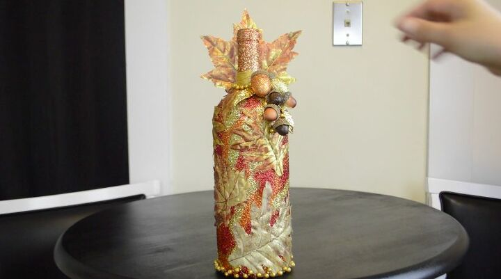 s 18 fun ways to add glitter to your home decor, Fall Bottle Decor