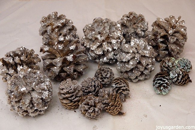 s 18 fun ways to add glitter to your home decor, Sparkling Pine Cones