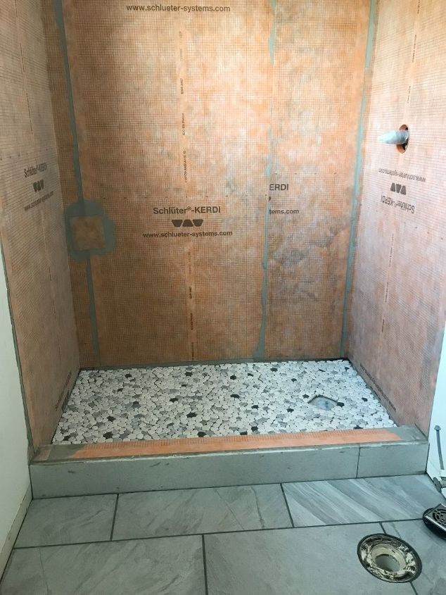 q how do you prevent over grouting pebbles in a shower floor