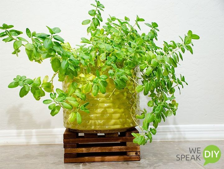 s gardeners copy these 20 stunning ways to display your plants, Craft A Stand For The Porch Out Of Scrap Wood