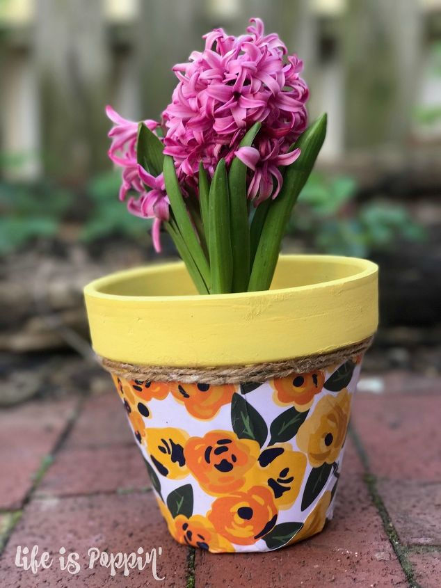 s 22 idea to make your terra cotta pots look oh so pretty, Decoupage it with decorative paper