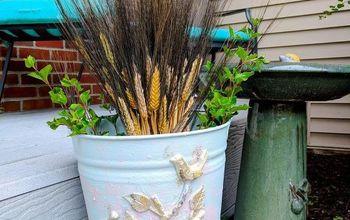 old metal bucket repurposed into charming farmhouse decor