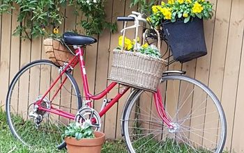 red bicycle planted up as garden art