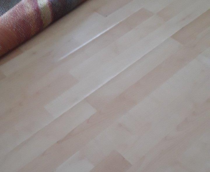 q how to repair warped flooring