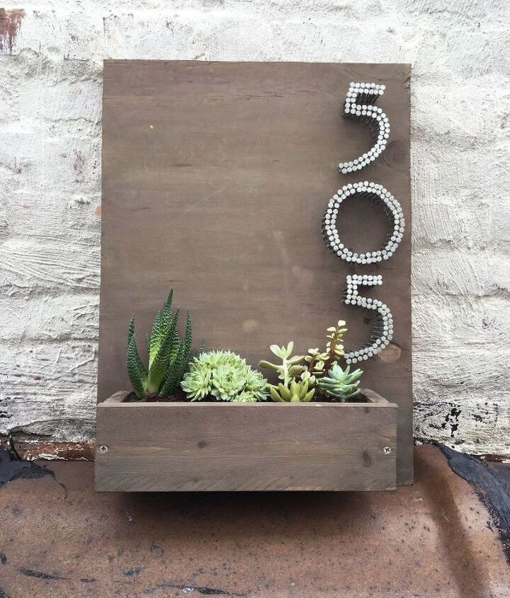 s 13 spectacular waysto display your house number, Planter House Number