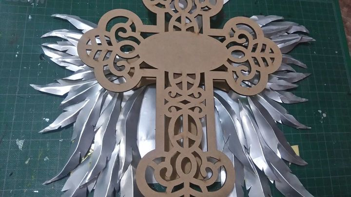 wooden cross with aluminum can wings