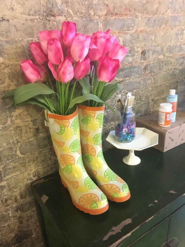 s check out these adorable container garden ideas to copy this spring, Old Rain Boots Turned Planter