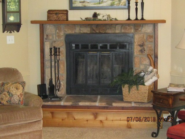 q i want to update and lighten a artificial stone fireplace