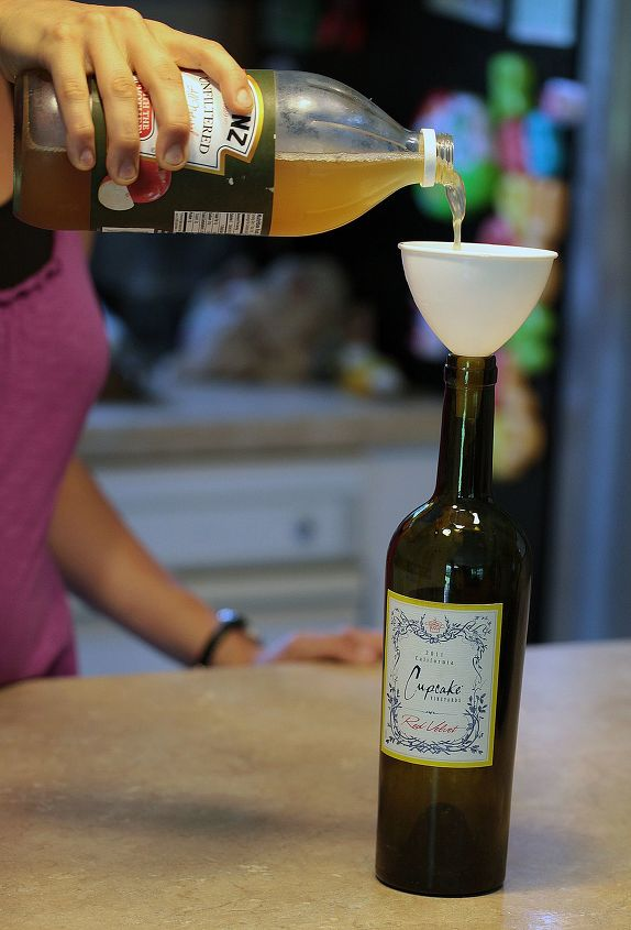 s 30 helpful gardening tips you ll want to know, Trap flies with apple cider in a wine bottle