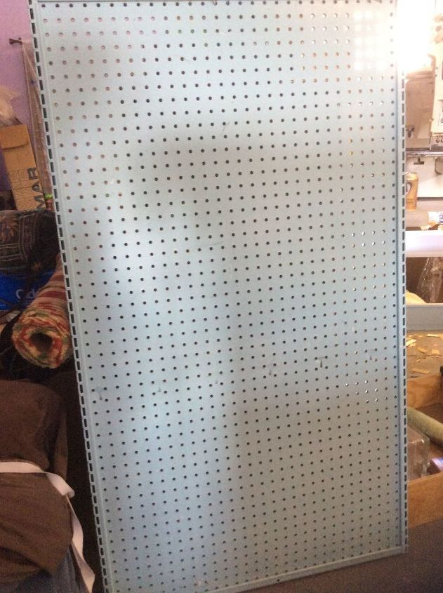 q attaching retail style pegboard shelves to the wall