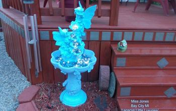 recycle water fountain into solar night time decor for garden