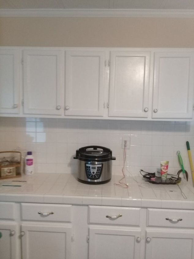 q what can i do to all white square tiles on counter tops and all backpl
