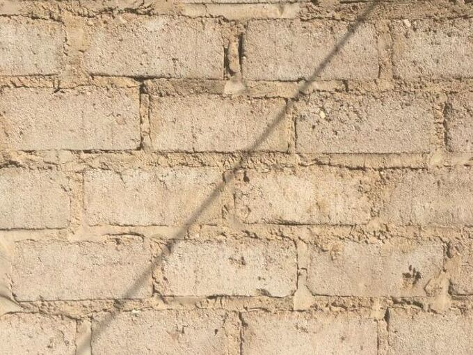 q is it possible to apply gamazine directly on a concrete brick wall