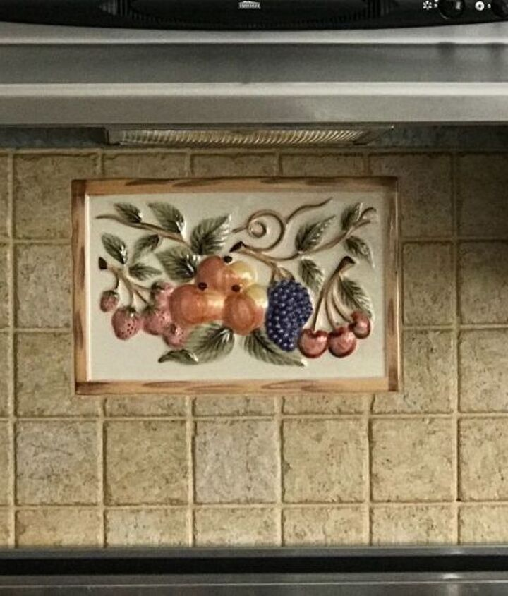 q change of tile plaque