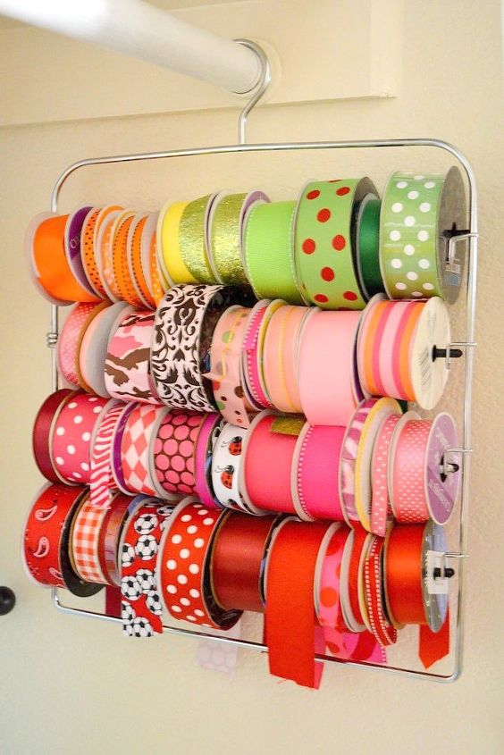 s 23 insanely clever ways to eliminate clutter, Keep Ribbon Spools on a Pants Hanger