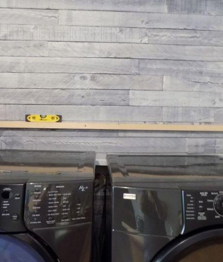 diy floating wood shelf laundry room