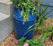 using upcycled vintage junk for garden decor, Vintage Milk Can used as a Planter