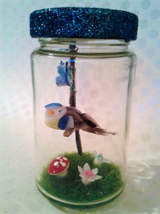 planter in jar garnished with a fairy garden led