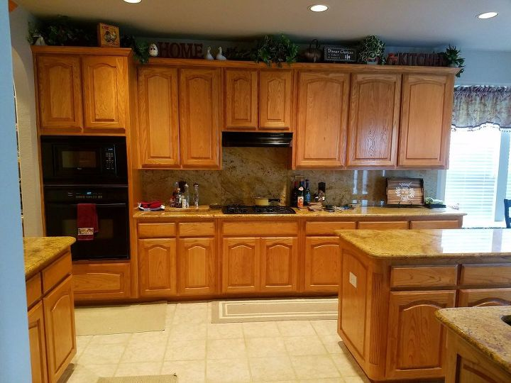 q we have a love hate relationship with our honey oak kit cabinets