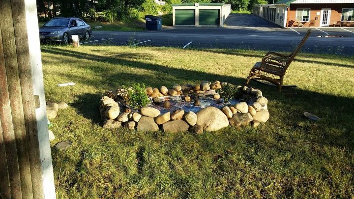 q how can i line a rock garden organically to keep soil from seeping