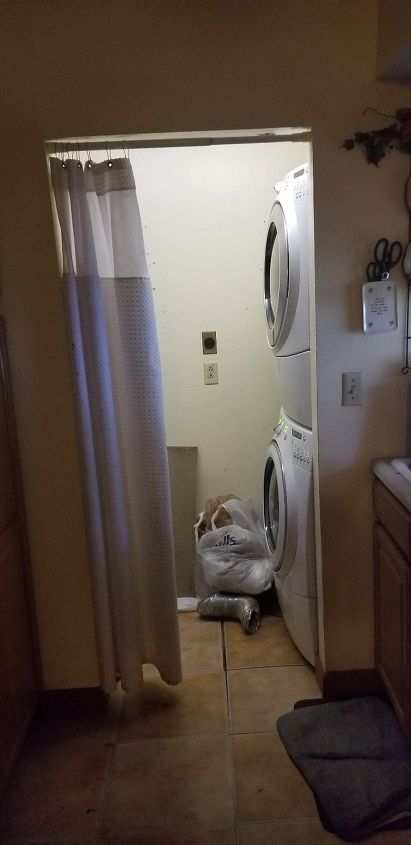 q i have a tiny laundry room hot water heater space work around