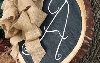 tree trunk slice initial chalkboard with burlap bow