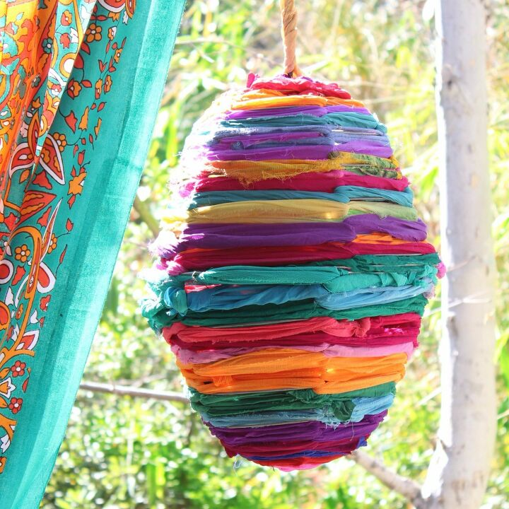 s 16 brilliant wire basket hacks everyone s doing right now, Weave In Colorful Fabric For A Boho Lamp