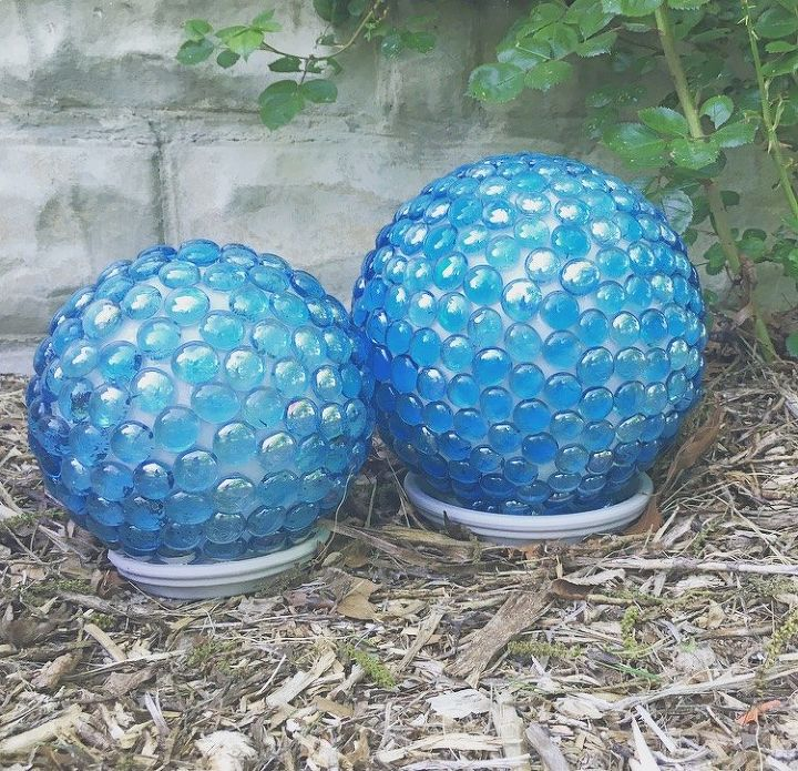 s 15 amazing ideas you can make with dollar store gems, Make pretty garden globes for your yard