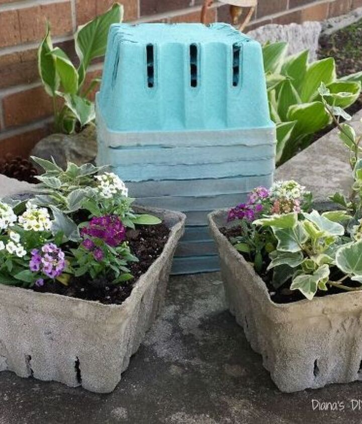 s 20 easy concrete projects that anyone can make, Concrete Dipped Berry Box Planters