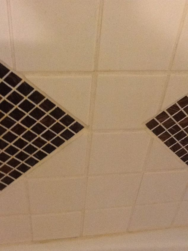 q how do i clean the grout in my shower