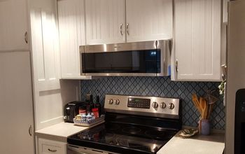 extending the arabesque backsplash with adhesive mat