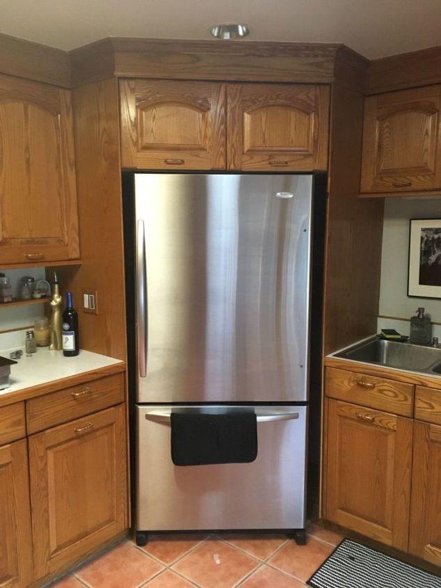 q how do i get rid of the space around my fridge