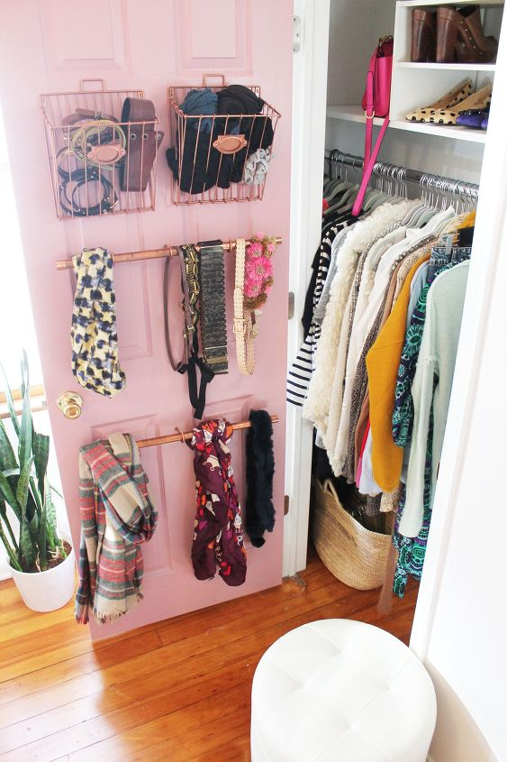 s 30 genius ways to make the most of your closet space, Put stylish pipe hangers inside your door