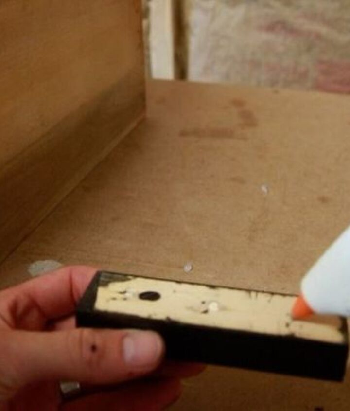 Hot gluing the drawer pull to the dresser